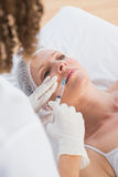 Woman receiving botox injection on her lips Royalty Free Stock Photos