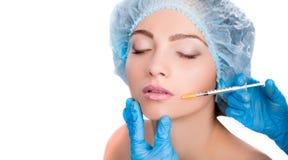Woman receiving  botox injection Stock Photo