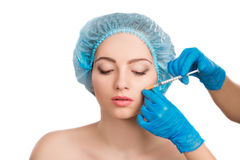 Woman receiving  botox injection Stock Images