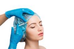 Woman receiving  botox injection Royalty Free Stock Photos