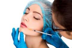 Woman receiving  botox injection Stock Image
