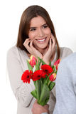 Woman receiving a bouquet Royalty Free Stock Photography
