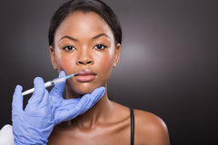 Woman receiving cosmetic injection Stock Images