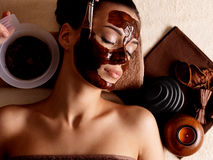 Woman receiving cosmetic mask in spa salon Royalty Free Stock Image