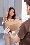 Woman receiving courier from delivery man Royalty Free Stock Photos