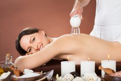 Woman Receiving Cupping Massage At Spa Royalty Free Stock Photography