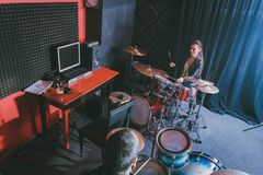Woman receiving drum lessons from her music teacher stock image