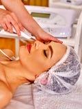 Woman receiving electric facial peeling massage. Stock Photography