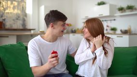 Woman receiving engagement ring explosion of happiness. Marriage Proposal - A man gives a ring to a woman proposing. Young man making marriage proposal to stock footage