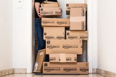 Woman receiving extensive Amazon.com delivery Stock Photography