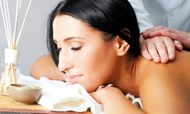 Woman receiving facial massage Royalty Free Stock Photography