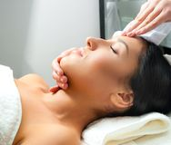Woman receiving facial massage Stock Photos