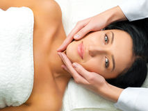 Woman receiving facial massage Stock Image