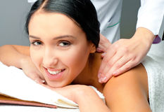 Woman receiving facial massage Royalty Free Stock Image