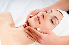 Woman receiving facial massage royalty free stock photo