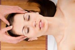 Woman receiving facial massage Stock Images