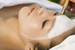 Woman Receiving Facial Treatment Royalty Free Stock Photos