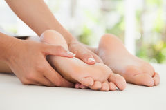 Woman receiving a foot massage Stock Photography