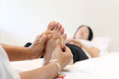 Woman receiving a foot massage Royalty Free Stock Photos