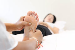 Woman receiving a foot massage Stock Photo