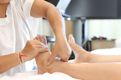 Woman receiving a foot massage Stock Images