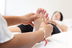 Woman receiving a foot massage Stock Image