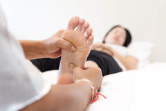 Woman receiving a foot massage Royalty Free Stock Images