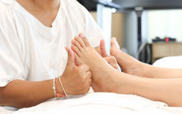 Woman receiving a foot massage Royalty Free Stock Image