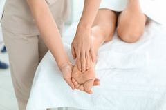 Woman receiving foot massage in wellness center. Closeup royalty free stock images