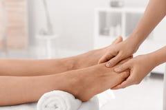 Woman receiving foot massage in wellness center,. Closeup stock photography