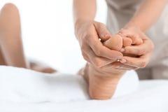 Woman receiving foot massage in wellness center. Closeup royalty free stock photos