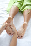 Woman receiving foot reflexology Stock Photography
