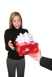 Woman Receiving a Gift Stock Image