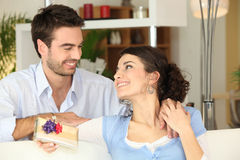 Woman receiving gift Stock Images