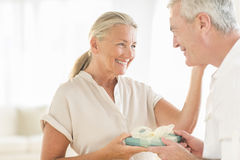 Woman Receiving Gift From Man At Home Royalty Free Stock Photo