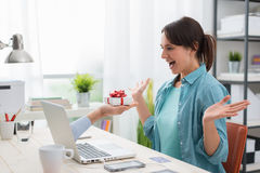 Woman receiving a gift from a website Stock Photos