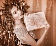 Woman receiving gifts.  Black and white retro. Royalty Free Stock Images