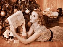 Woman receiving gifts.  Black and white retro. Royalty Free Stock Photo