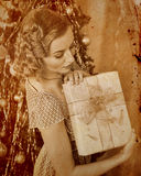 Woman receiving gifts.  Sepia toned. Stock Images