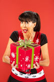 Woman receiving or giving large Christmas gift Royalty Free Stock Image