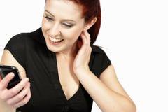 Woman receiving good news at work Stock Photos