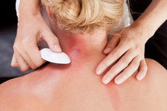 Woman Receiving GuaSha Treatment on Neck Royalty Free Stock Photography