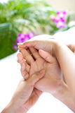 Woman receiving hand massage Royalty Free Stock Images