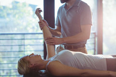 Woman receiving hand therapy exercises from physiotherapist Royalty Free Stock Photos
