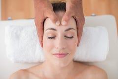 Woman receiving head massage Royalty Free Stock Photos