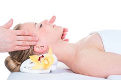 Woman receiving a head massage in spa. stock photo