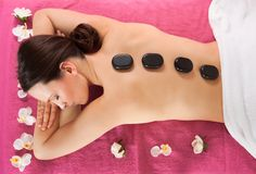 Woman Receiving Hot Stone Therapy In Spa Stock Photos