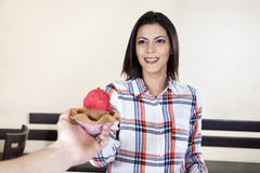 Woman Receiving Ice Cream From Waiter In Parlor Stock Photo