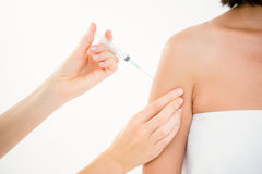 Woman receiving injection on arm Stock Images