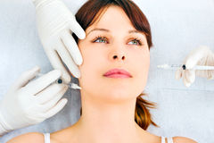Woman receiving an injection of botox Stock Images